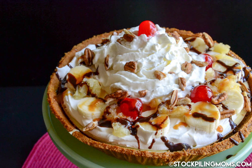 Are you looking for the most amazing dessert that you have ever eaten in your entire life?  If so then Banana Split Cheesecake Recipe is for you! It is more than delicious.  I made this for my husband and he said it was the best dessert he has ever eaten!  This is a favorite summer dessert but best of all there is no reason to reserve it solely for summer.  If you love banana splits and cheesecake then you are going to fall in love with this dessert.