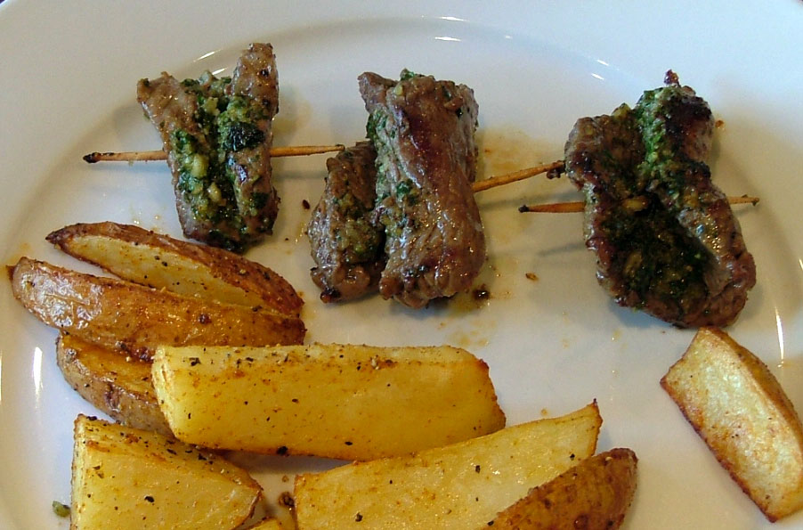 Gluten Free Flank Steak Pesto Rollups are tasty and perfect for company. You can prep them in advance and cook when it is time to eat.