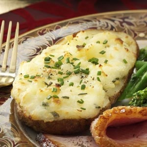 Originally published as Cheese-Stuffed Twice-Baked Potatoes in Taste of Home's Holiday & Celebrations Cookbook Annual 2011, p10