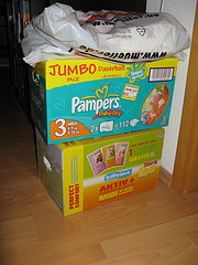 IMG_0008.JPG - Pampers boxes full of baby clothing