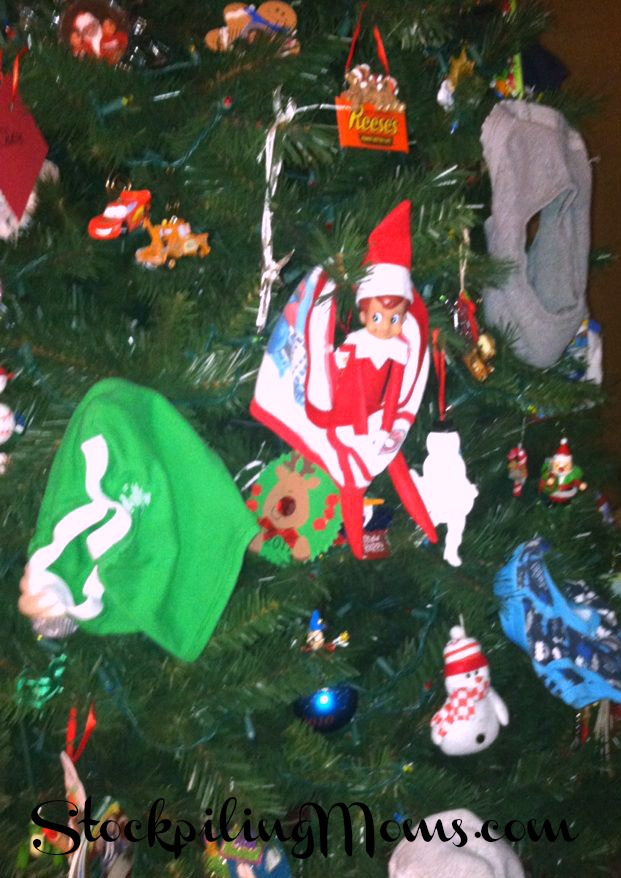 Our elf decided play an old camp trick. Since they don't have a flag pole the Christmas tree will do!!