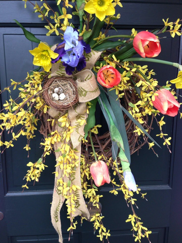 The burlap bow and egg nest are the perfect finishing touch to this beautiful spring wreath.
