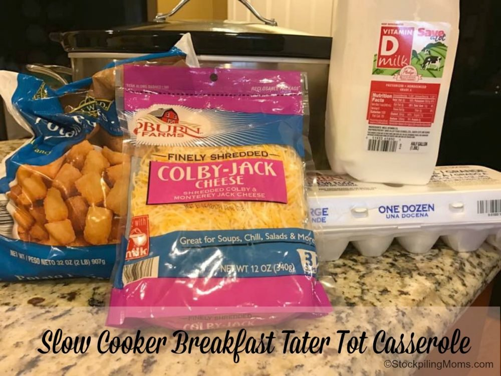 It doesn't get any easier than this slow cooker breakfast tater tot casserole recipe and it is crowd pleaser too!