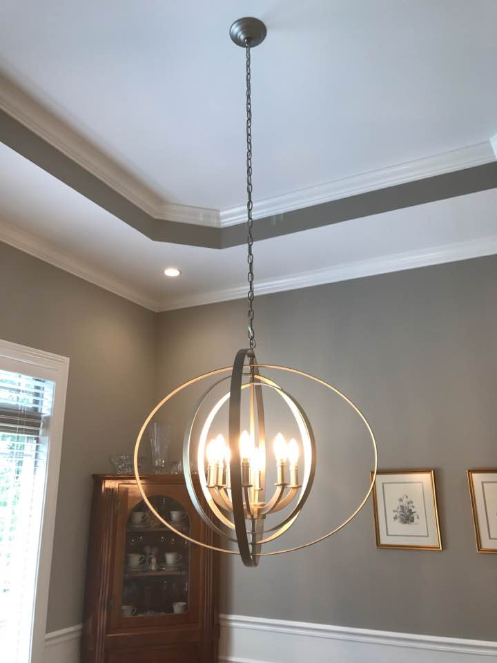 A Traditional Dining Room Design with Show Stopping Lighting